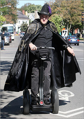 Christian Day, a Warlock, rode Segway on Lafayette Street.