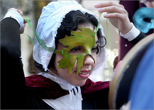 Already in costume, Kelly-Marie McCartney of Somerville, N.J. tried on a mask for a new look.