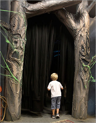 Caelen Camacho, 4, of Winthrop seemed apprehensive as he peeked into Griswold's Ghostly Grove.