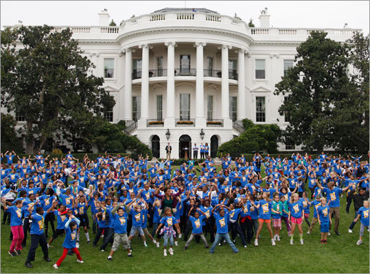 Michelle Obama asked Americans this week to join her in one minute of jumping jacks in an effort to set a new world record for the most people jumping repeatedly into an X position in a 24-hour period. As part of the attempt as breaking the record, the president's wife hosted several hundred local schoolchildren at the White House to jump around.