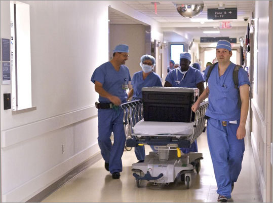 A team of surgeons wheeled a cooler with the donor tissue through the halls of the operating rooms at Brigham and Women's.