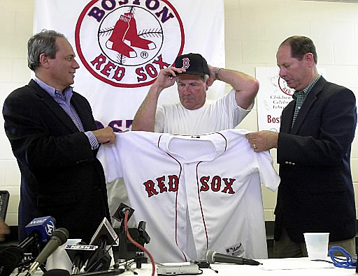 Mike Port Years: 2002 Immediately after John Henry bought the Red Sox in 2002, the team named Mike Port to serve as interim general manager to replace Dan Duquette. Port had been with the team since 1993 had most recently served as vice president of baseball operations. In March 2002 Port (pictured to the right) and President/CEO Larry Lucchino announced the hiring of Grady Little as manager of the team.