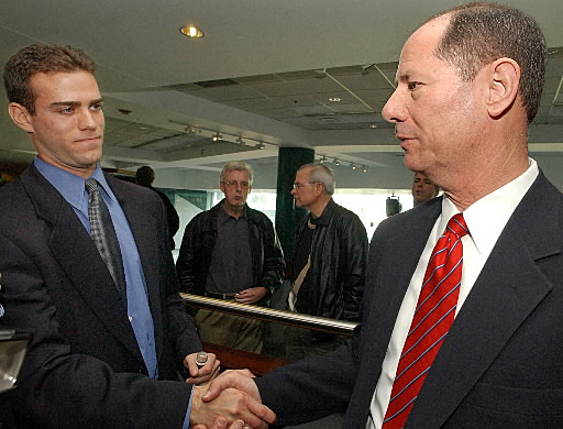 The Red Sox won 93 games in 2002 with the help of general manager Mike Port's mid-season acquisition of Cliff Floyd. But the team still missed the playoffs. Port returned to his role as vice president of baseball operations when Theo Epstein was named general manager in November 2002. The two men, pictured here, shook hands at a press conference at the .406 Club at Fenway Park. Port remained with the team through 2004 when it won its first World Series in 86 years.