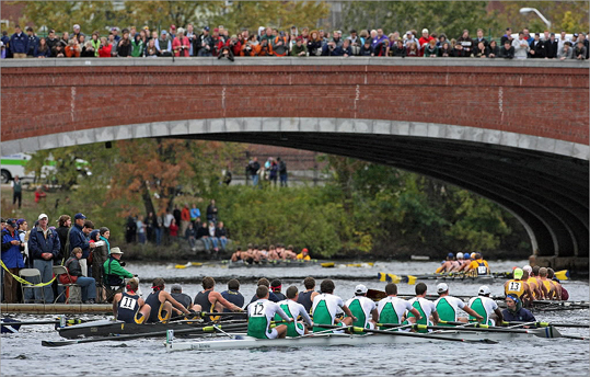 The river at bottom right, the dock at left and the Eliot Bridge at the top were all full of people, as competitors in the Collegiate Men's Eights headed into the final leg of the race.