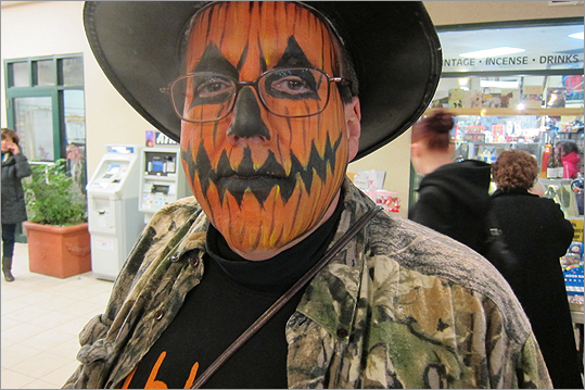 Ken Powell of Pennsylvania had his face painted in the Museum Place Mall.