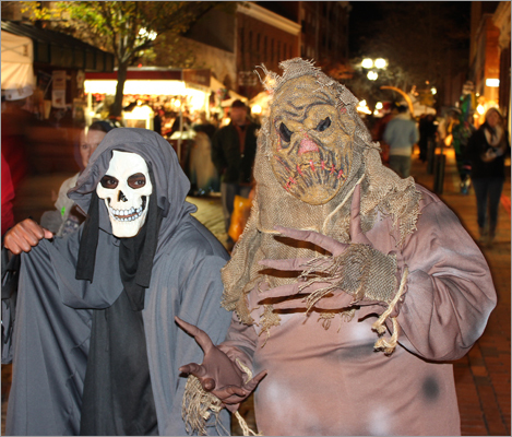 The Grim Reaper, also known as Jermain Ross, of Taunton, and the Scarecrow, or Auguste Lewis, of Dorchester, spent their first Halloween weekend in Salem working for the Witch Mansion Haunted House on Essex Street. 'There's no other place on Earth like it,' Ross said of the Witch City.