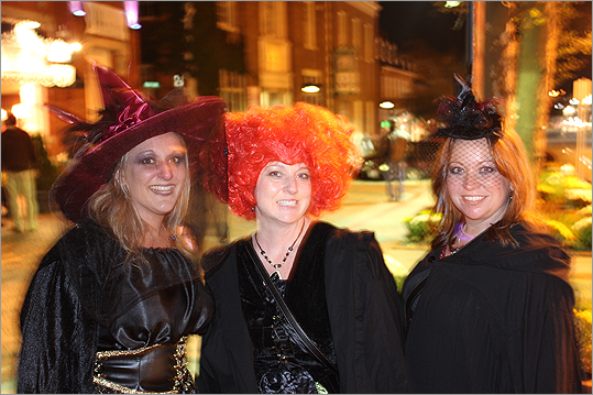 From left, Stephanie Bondyra, Janet Schindler and Nicole Parker, all of Baltimore, gave their impression of the Sanderson sisters from the movie 'Hocus Pocus.' This was their first year visiting Salem.