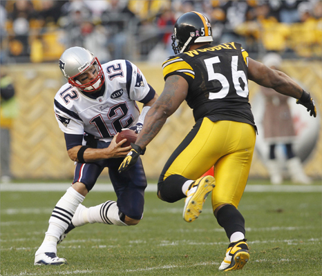 New England Patriots Tom Brady (12) couldn't avoid a sack by Pittsburgh Steelers LaMarr Woodley (56) in the second quarter.