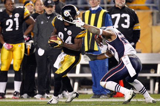 Antonio Brown (84) of the Pittsburgh Steelers had his facemask pulled by Patrick Chung (25) of the New England Patriots at Heinz Field.