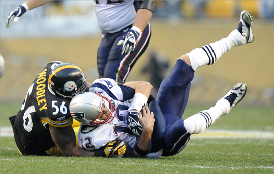 Pittsburgh Steelers outside linebacker LaMarr Woodley (56) sacked New England Patriots quarterback Tom Brady (12).