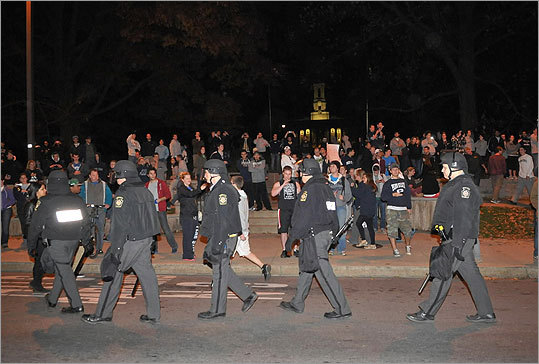 Police walked down College Avenue as students protested.