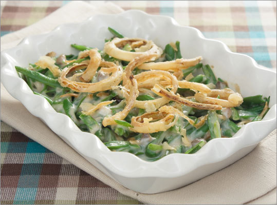Instead of making the same old green bean and mushroom soup casserole topped with those fat-laden packaged fried onion rings, consider stir-frying the fresh green beans with a little olive oil, garlic, and a smidge of salt and pepper for a healthier veggie side. Or, try this easy-to-make Lemon-walnut green beans recipe. Calories saved: 135