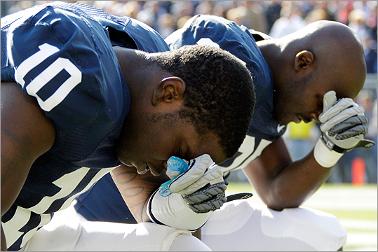 Before Penn State players took the field to play Nebraska on Saturday, for the team's first game without coach Joe Paterno at the helm in 46 years, players Malcolm Willis (left) and Silas Redd, knelt in prayer. Paterno and university president Graham Spanier were both fired earlier this week by the university board of directors, amid a child sex abuse allegations against former assistant coach Jerry Sandusky.