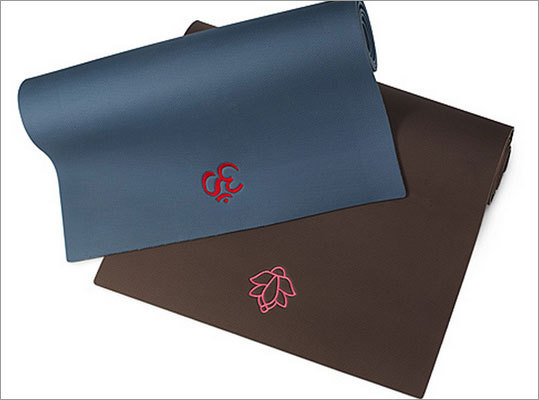Embroidered yoga mats Price: $ 60 These yoga mats will help any yoga-lover stay centered with embroidered focal points of either an om symbol or lotus flower.