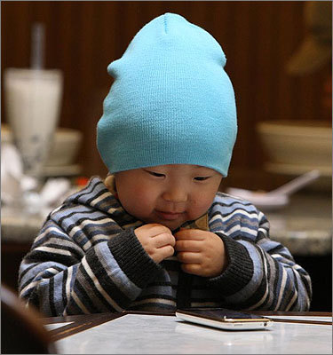 Justin Jung Min, a Korean American baby, relaxed in a Vietnamese restaurant in Allston Village.
