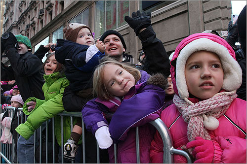 Kaitlin Yost, 4, (center) and Anna Hogrefe, 8, watched the parade on 42nd Street.