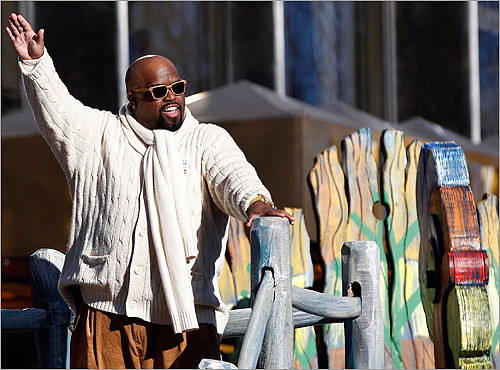 Singer Cee Lo Green waved from a float.