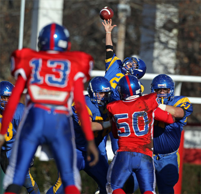 As South Boston's Kenneil Toney (13) waited to recieve, a snap on a first half punt attempt sailed over the head of East Boston's Anthony Whitney, and after the ball stopped rolling, South Boston had good field position. East Boston played South Boston in a Thanksgiving Day game at White Stadium.
