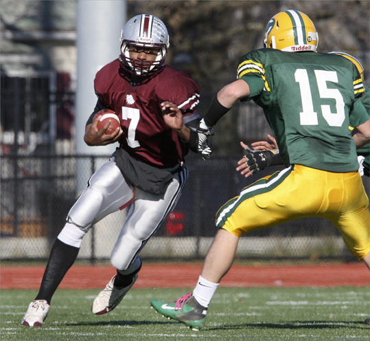 Lynn English's quarterback Jermain Kelley (7) ran during a Thanksgiving Day football game between Lynn Classical and Lynn English.