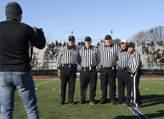 Before the start of the Thanksgiving Day football game between Lynn Classical and Lynn English at Manning Field in Lynn, Mass., officials (l-r) Dan Strabone, Anthony Pizzimenti, Ron Fusco Dave Pinciaro and C.J. Cann posed for a photo. They called themselves an all-Italian crew. For Strobone, it was his 41st Thanksgiving Day Game, the first was at the old Manning Bowl.