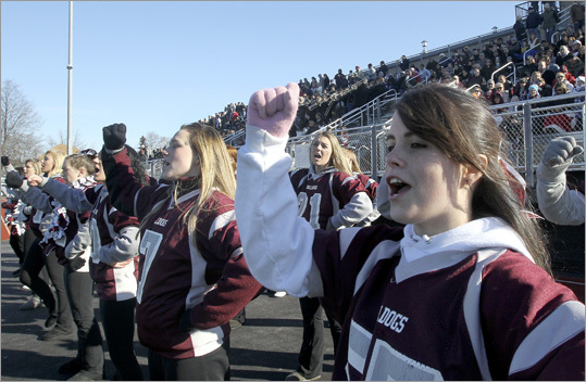 Lynn English cheerleaders, including (right) Aleigha Bontos supported their team during Thanksgiving Day football game between Lynn Classical and Lynn English.