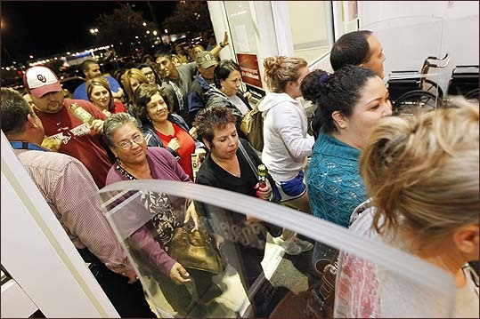 Black Friday shoppers at this Kohl's in Corpus Christi, Texas, filed into the store after its midnight opening in search of savings.