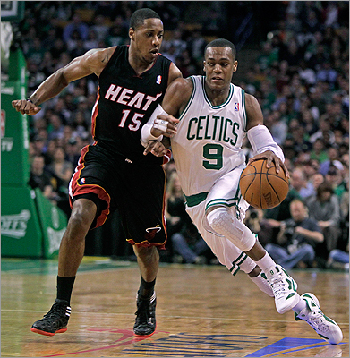 Asked which player he was most looking forward to seeing play now that the lockout is over, Wilkens said, 'Rondo,' as in Rajon Rondo, right, with Mario Chalmers of the Miami Heat. 'I like Rondo because he's small, and he's fast,' Wilkens said.