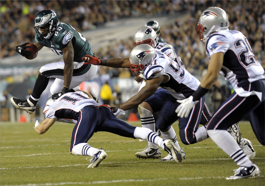 Philadelphia Eagles running back LeSean McCoy (25) tried to get away from New England Patriots wide receiver Julian Edelman (11), middle linebacker Jerod Mayo (51), outside linebacker Rob Ninkovich (50) and free safety Patrick Chung (25) during the second half.