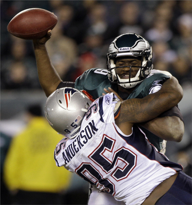 Philadelphia Eagles quarterback Vince Young (9) was sacked by New England Patriots defensive end Mark Anderson during the second half.