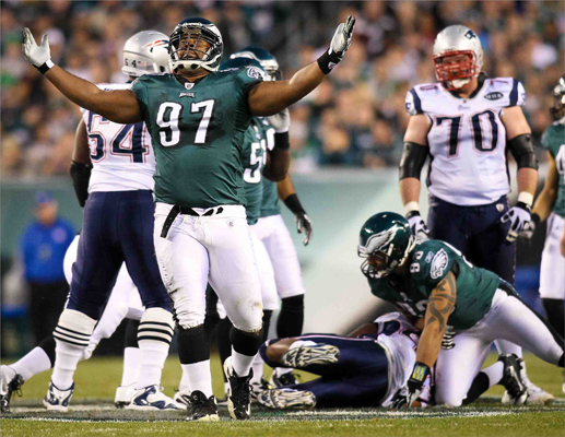 Philadelphia Eagles defensive tackle Cullen Jenkins (97) celebrates after making a tackle in the first half of an NFL football game against the New England Patriots in Philadelphia.