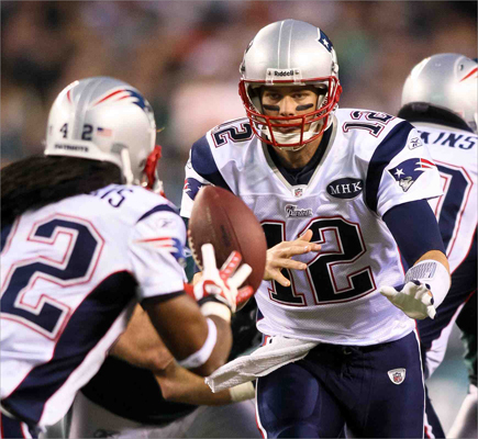 New England Patriots quarterback Tom Brady (12) pitched the ball to running back BenJarvus Green-Ellis in the first half of a win against the Philadelphia Eagles in Philadelphia on Sunday, Nov. 27.