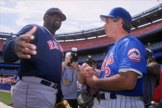 Valentine returned to the United States and joined the Mets organization as a minor-league manager. Late in the 1996 season, he was promoted to manager of the big league club. Here he chatted with Red Sox slugger Mo Vaughn in 1997. By 1999, Valentine had brought the Mets to the National League Championship Series, and the Mets made it to the World Series in 2000, where they lost to the Yankees.