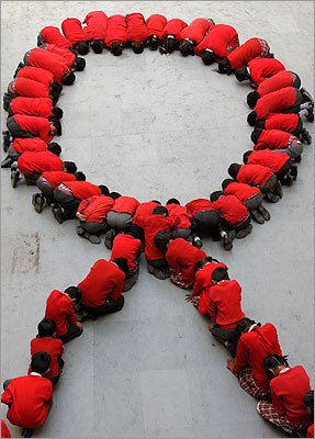 Indian school children formed a human red ribbon in Ahmadabad, India.