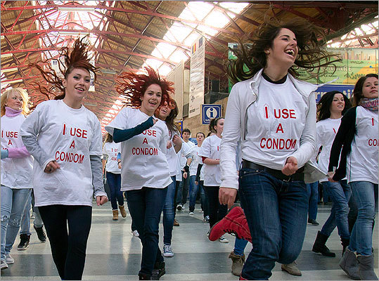 Romanian medical students danced during a flash mob event to raise awareness to the risk of being infected with the HIV virus, at the main railway station in Bucharest on Nov. 30, 2011, one day ahead of World AIDS Day.