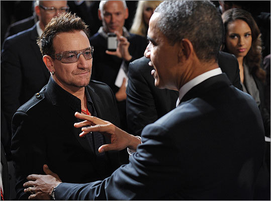 President Obama, chatted with musician Bono, left, as singer Alicia Keys looked on after speaking at George Washington University in Washington, D.C.
