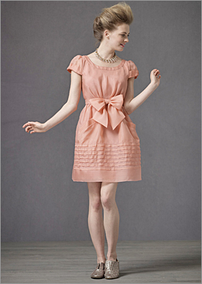A playful pink pinafore that's as pretty as the presents under the tree. Miraflores dress by Hitherto, BHLDN.com , $310.