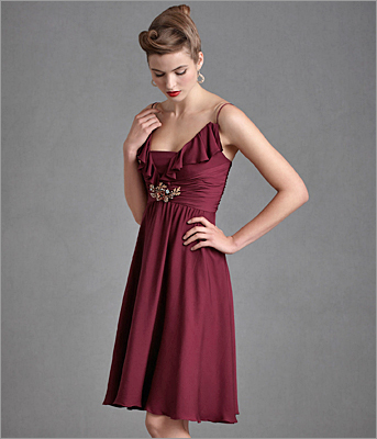 Flattering ruching and ruffles makes this berry frock a figure-friendly favorite. Couplet dress by Quilaree, BHLDN.com , $260.