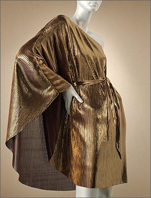 This bold metallic caped mini-dress will turn heads. Pleated foil asymmetrical dress by Jennifer Lopez, Kohls.com , $80.