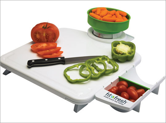 Smart Portion Prep Center This prep center has a cutting surface, food scale, portion tray and side measuring cup that measures up to 2 cups. The scale and measuring cup clip on to the board and detach for easy cleaning and storage. Price: $19.99