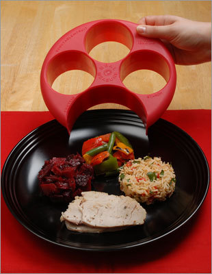 Meal Measure This handy device fits most dinner plates with labels on each section for vegetables, fruit, starch, and protein. Each area is one cup if filled to the top with a half cup marker line inside as well. Price: $19.99