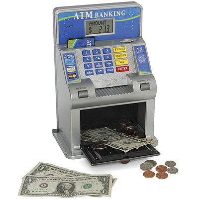 ATM for kids Give kids a toy ATM like this one from Hammacher Schlemmer for $39.95. Kids can deposit real coins and bills on this machine up to $999.99 and it displays accurate, up-to-date account information on the screen. Kids even get their own ATM card and PIN.