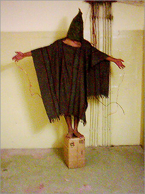 An unidentified detainee stood on a box with a bag on his head and wires attached to him in late 2003 at the Abu Ghraib prison in Baghdad.