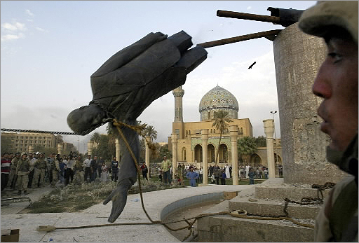 US soldiers and Iraqi civilians toppled a statue of Saddam Hussein in downtown Baghdad on April 9, 2003. The 20-foot high statue had been erected a year earlier, on Saddam's 65th birthday.