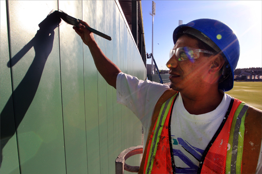 In December 2011, Stan Grossfeld visited Fort Myers to check the progress of the construction. The remaining photos in this gallery are from that visit. Salvador Navarrete of Service Painting applied finishing touches to the Green Monster in left field.