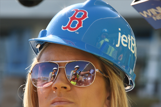 Katie Haas, director of Florida Business Operations, was reflected in the sunglasses of Kelly Creswell, a Fort Myers television reporter.