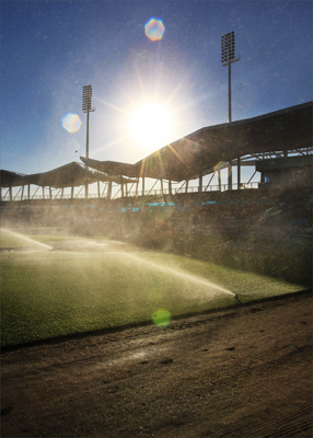Sunlight bathed the ballpark early in the morning when the sprinklers were going.