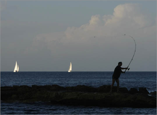 3. Malta, Venezuela Minimum vacation: 24 days Public holidays: 12 (Venezuela); 14 (Malta) Pictured: An amateur angler casts his fishing rod as yachts sail by in Sliema, Malta.