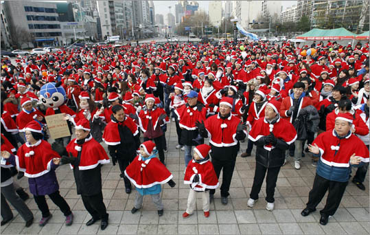 7. South Korea Minimum vacation: 19 days Public holidays: 15 Minimum vacation is only for employees with 10 years at the same company. Pictured: The annual Santa Marathon race in Seoul .