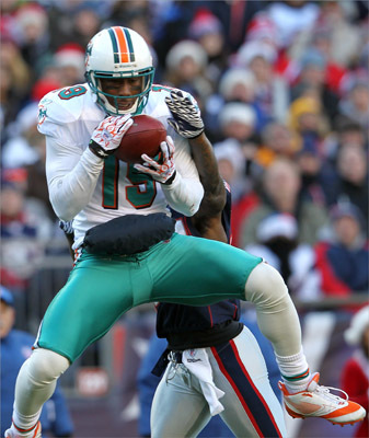 Brandon Marshall of the Miami Dolphins caught a touchdown pass against the New England Patriots in the second quarter. At the two-minute warning of the first half, the Dolphins had a 17-0 lead.
