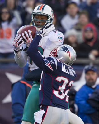 Miami Dolphins Brandon Marshall hauled in a long pass over New England Patriot Devin McCourty during second quarter action. Coming into today's game, Marshall had 1,021 yards receiving on the season.